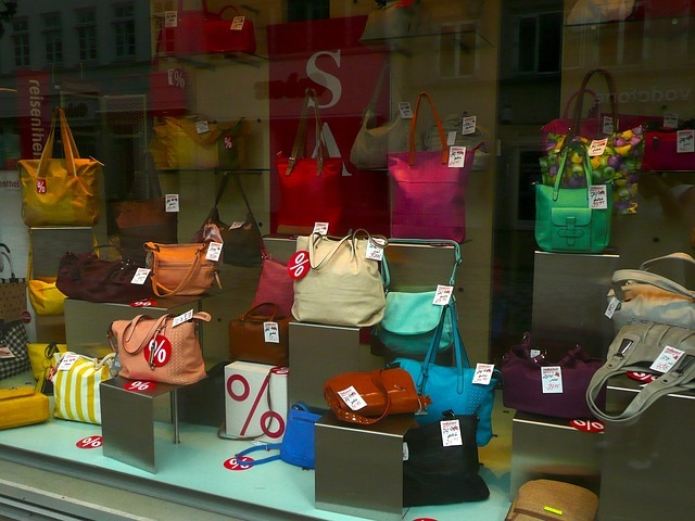Retail storefront with multicolored handbags