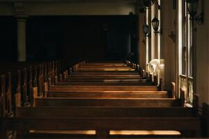 Rows of pews in a church