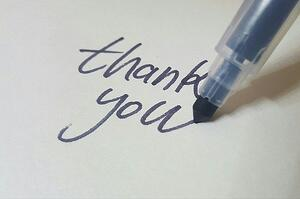 Blue marker writing thank you