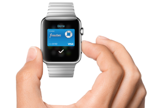 Hand holding a smartwatch making a frictionless payment