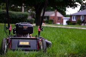 lawn-mower-sitting-on-grass