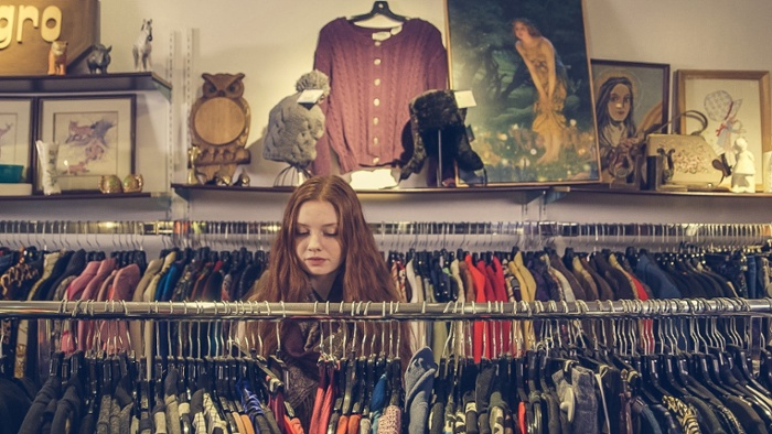 Young consumer in consignment shop