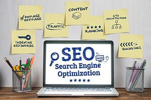 Search engine optimization on laptop with post-it notes