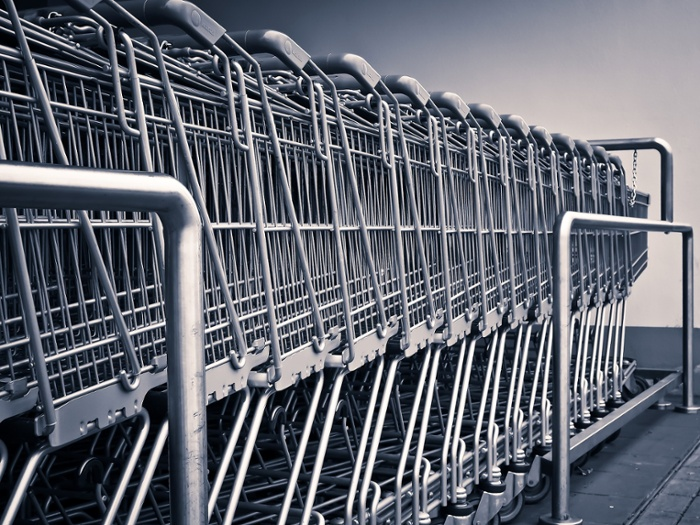 Line of shopping carts in a corral
