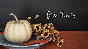 White pumpkin on a plate with Give Thanks